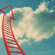 Red ladder arrow pointing up against sky — Stock Photo
