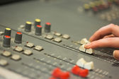 Student working on sound mixer adjusting levels — Stock Photo