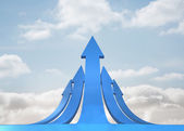 Blue curved arrows pointing against sky — Stock Photo