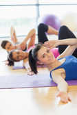 Class and instructor doing stretching pilate exercises — Stock Photo