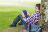 Student using his tablet pc outside — Stock Photo