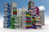 Piles of books against sky — Stock Photo