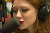Pretty redhead student hosting a radio show — Stock Photo