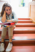 Troubled student sitting on stairs — Stock Photo