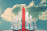 Red and grey arrows pointing up against sky — Stock Photo