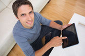 Overhead view of man using digital tablet in living room — Stock Photo