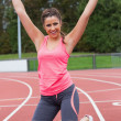 Stock Photo: Toned young womcheering on running track