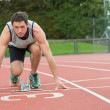 Stock Photo: Young mready to race on running track