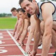 Young people ready to race on track field — Stock Photo #38463903