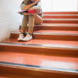 Upset student sitting on stairs — Stock Photo #38465387