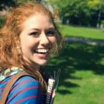 Cheerful student looking at camera — Stock Photo