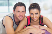 Young woman and man with cropped fitness ball at a gym — Stock Photo