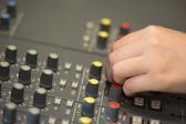 Hand working on a sound mixing desk — Stock Photo