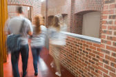 Students walking in the hall together — Stok fotoğraf