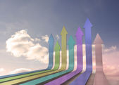 Colourful arrows pointing up against sky — Stock Photo