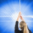 Composite image of businesswoman pulling a chain — Stock Photo