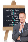 Smiling businessman holding glasses — Stock Photo
