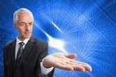 Concentrated businessman with palm up — Stock Photo