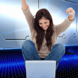 Brunette cheering while using laptop — Stock Photo