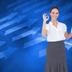 Composite image of stylish businesswoman making gesture — Stock Photo #38480893