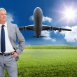 Man in a suit with his hands on his hips — Stock Photo #38481027