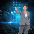 Composite image of young businesswoman pointing to something — Stock Photo