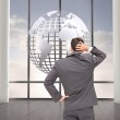 Composite image of young businessman standing back to camera — Stock Photo