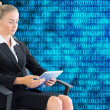 Stock Photo: Composite image of businesswomsitting on swivel chair with tablet