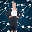 Stock Photo: Composite image of businesswomstanding with hands on hips