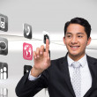 Stock Photo: Composite image of smiling asian businessman pointing