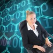 Businesswoman sitting on swivel chair with laptop — Stock Photo #38488967