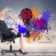 Composite image of businesswomsitting in swivel chair — Stock Photo #38489593