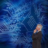 Thoughtful mature businessman posing — Stock Photo