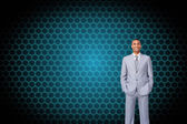 Attractive businessman with hands in pockets — Stock Photo