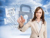 Businesswoman touching invisible screen — Stock Photo