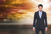 Composite image of serious asian businessman — ストック写真