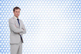 Serious businessman with arms folded — Stock Photo