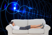 Business woman lying on couch — Stock Photo