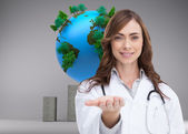 Leende läkare presentera hennes hand — Stockfoto