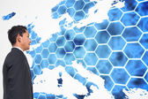 Composite image of background with hexagons and europa map — Stock Photo