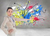 Unsmiling asian businesswoman pointing — Stock Photo