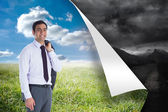 Composite image of smiling businessman standing — Stock Photo