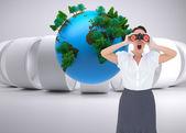Shocked businesswoman looking through binoculars — Stock Photo