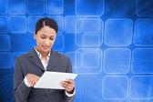 Saleswoman with touch screen computer — Zdjęcie stockowe