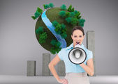Composite image of furious classy businesswoman talking in megaphone — Stock Photo