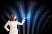 Composite image of smiling businesswoman raising her hand — Stock Photo