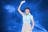 Composite image of furious classy businesswoman throwing her calculator — Stock Photo