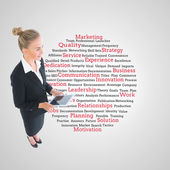 Composite image of businesswoman holding new tablet — Stock Photo