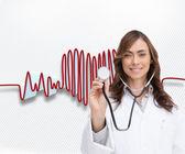 Happy doctor using stethoscope — Stock Photo