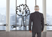 Composite image of businessman walking away from camera — Stock Photo